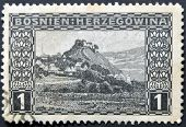 A stamp printed in Bosnia and Hercegovina shows Doboj a village in mountains