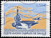 A stamp printed in France shows Charles de Gaulle aircraft carrier