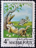 A stamp printed in Hungary show illustration for fairy tale Hare and the Tortoise