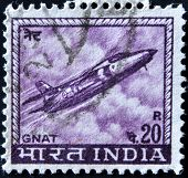 A stamp printed in India shows a Folland Gnat fighter jet from the Indian Airforce