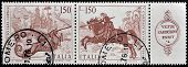 A stamp printed in Italy shows St. George slaying the dragon by Vittore Carpaccio
