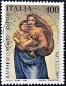 ITALY - CIRCA 1983: A stamp printed in Italy shows the Virgin and Child by Raphael Sanzio circa 1983