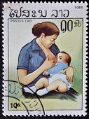 Laos- Circa 1985: A Stamp Printed In India Shows Woman Breast-feeds The Baby, Circa 1985