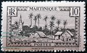 A stamp printed in Martinique shows the Village of Basse Pointe circa 1960