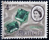 RHODESIA - CIRCA 1964: A stamp printed in Rhodesia shows emeralds