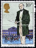 a stamp shows Sir Rowland Hill originator of penny postage reformer of postal system