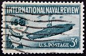 stamp printed in USA shows Aircraft Carrier and Jamestown Festival Emblem