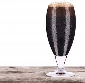 Frosty Glass Of Dark Beer Isolated