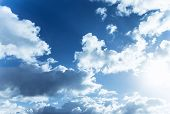 Beautiful blue cloudy sky, sun shine, abstract natural background, cloudscape, fluffy cumulonimbus clouds, spring nature