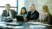 stock photo of business meetings  - A group of business people discuss things at a meeting - JPG