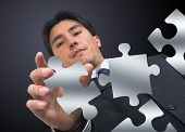 Business Man Arranging Puzzle