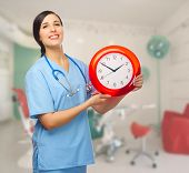Doctor with clock at medial office