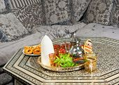 Traditional heavy Moroccan Sugar Cone or Qalib Sukar and tea tray with Ramadan cookies - sugar cones