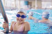 happy children kids group  at swimming pool class  learning to swim