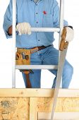 Closeup of  a carpenter climbing a ladder isolated over white. The man wearing a work shirt, jeans,