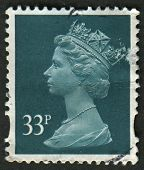 UK-CIRCA 2000: A stamp printed in UK shows image of Elizabeth II is the constitutional monarch of 16