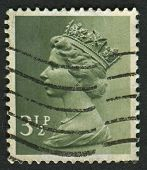 UK-CIRCA 1971: A stamp printed in UK shows image of Elizabeth II is the constitutional monarch of 16