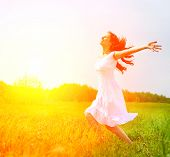 Enjoyment. Free Happy Woman Enjoying Nature. Beauty Girl Outdoor. Freedom concept. Beauty Girl over Sun