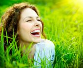 stock photo of teeth  - Beautiful Young Woman Outdoors - JPG