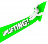 The word Uplifting on an arrow with person riding it up to illustrate success and being motivated wi