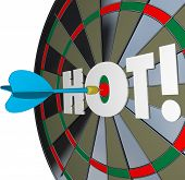 A dart hits the center of a bulls-eye with the word Hot to illustrate a great job or perfomance and