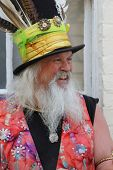 ROCHESTER, UK - MAY 5 : Man with traditional costume and feathers in hat at Rochester Sweeps Festiva