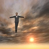 Conceptual concept of businessman or man in crisis walking in balance on rope over sunset sky backgr