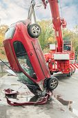 MOSCOW - OCT 9: Close-up large red rescue vehicle helps injured Peugeot 206 in car crash in the rive
