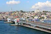 ISTANBUL - JUL 3: Cars driving over the Galata Bridge on a sunny day in Istanbul on July 3, 2012 in Istanbul, Turkey. The bridge length - 484 meters, width - 42 meters.