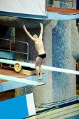 MOSCOW - APR 13: Athlete performs jump from springboard at Pool of SC Olympic on day of third phase