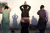 LHASA, TIBET-OCTOBER 08: Female Tibetan buddhist pilgrims are praying in front of Jokhang Temple on