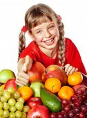 Child girl with group of  fruit. Isolated.