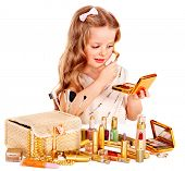 Child cosmetics. Little girl applying make up.