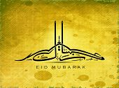 Arabic Islamic Calligraphy of  text Eid Mubarak on grungy yellow background.
