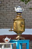 Copper samovar with white teapots