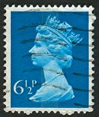 UK-CIRCA 1974: A stamp printed in UK shows image of Elizabeth II is the constitutional monarch of 16