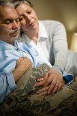 Loving elderly couple sleeping in bed sick husband