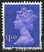 UK-CIRCA 1995: A stamp printed in UK shows image of Elizabeth II is the constitutional monarch of 16