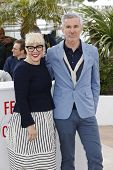 CANNES, FRANCE - MAY 15: Catherine Martin, Baz Luhrmann at the photocall for 'The Great Gatsby' at T