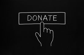 picture of generous  - Hand clicking Donate button drawn with white chalk on blackboard - JPG