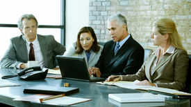 picture of business meetings  - A group of business people discuss things at a meeting - JPG