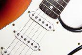 Vintage electric guitar close up, sunburst color .