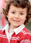 Adorable little child in red with curly hair