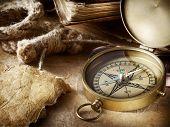 Vintage compass, old books, parchment