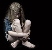 image of bruises  - Child abuse little frightened girl sitting in the dark - JPG