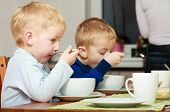 Boys Kids Children Eating Corn Flakes Breakfast Meal At The Table