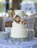 image of three tier  - three tiered wedding cake with flowers - JPG