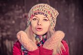 Young Woman Beautiful Winter Time Wearing Knitted Hat And Gloves And Blowing Air Kiss Lifestyle Expr