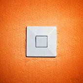 Vintage Light Switch On Orange Wall