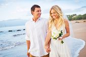 Bride and Groom Walking on Beautiful Tropical Beach at Sunset, Romantic Married Couple